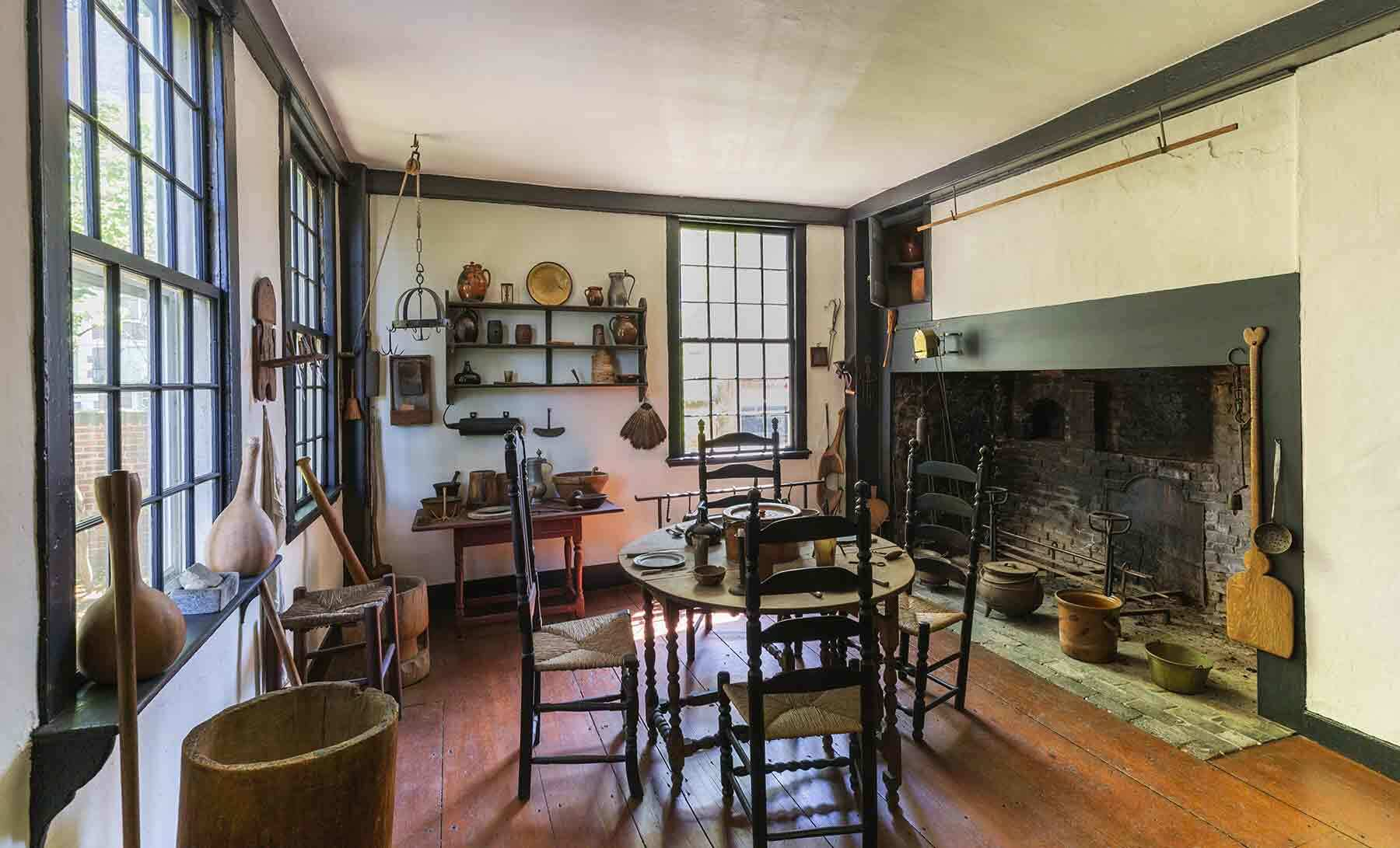 View of a kitchen and living room in a historic house