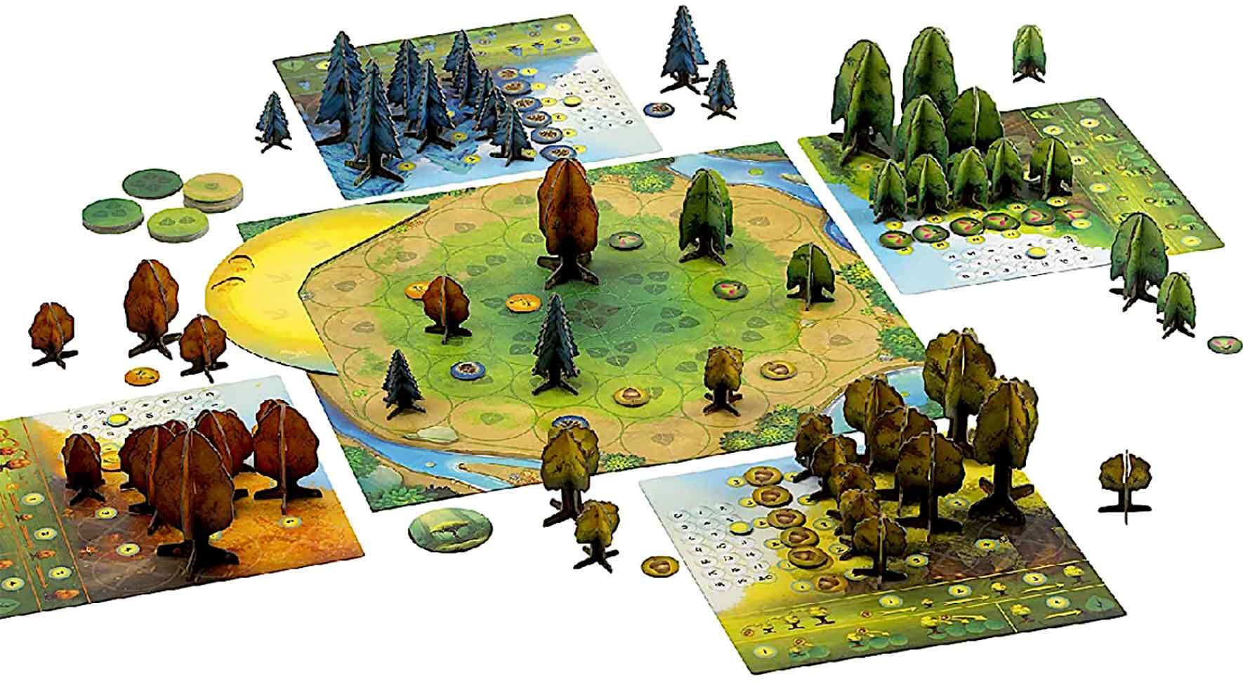 A board game with cut cardboard standing trees, grassy paths and streams
