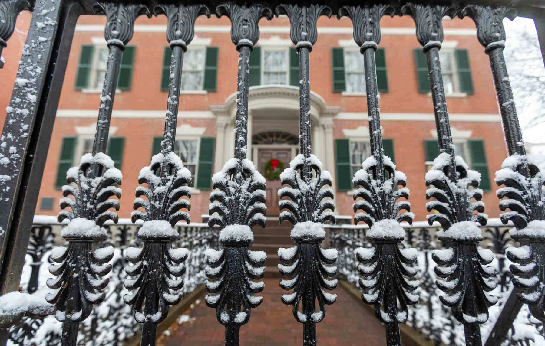 Gardner Pingree House front iron fence in winter