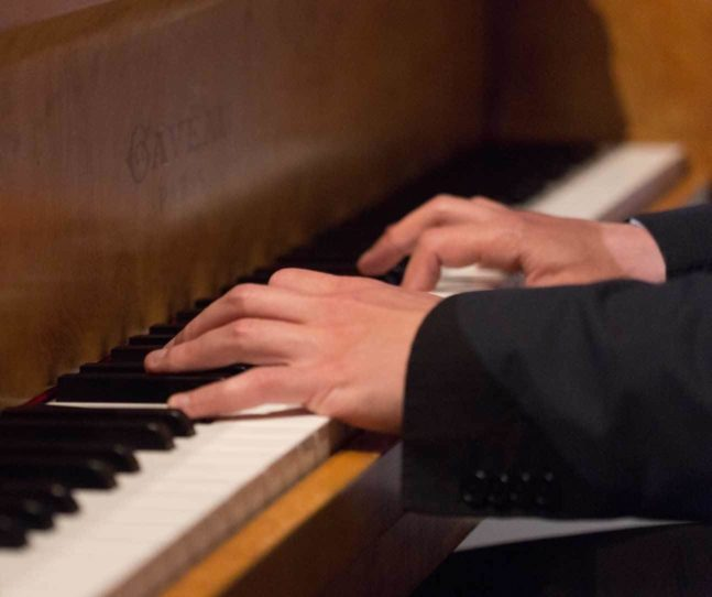 Bringing musicians aboard piano player hands