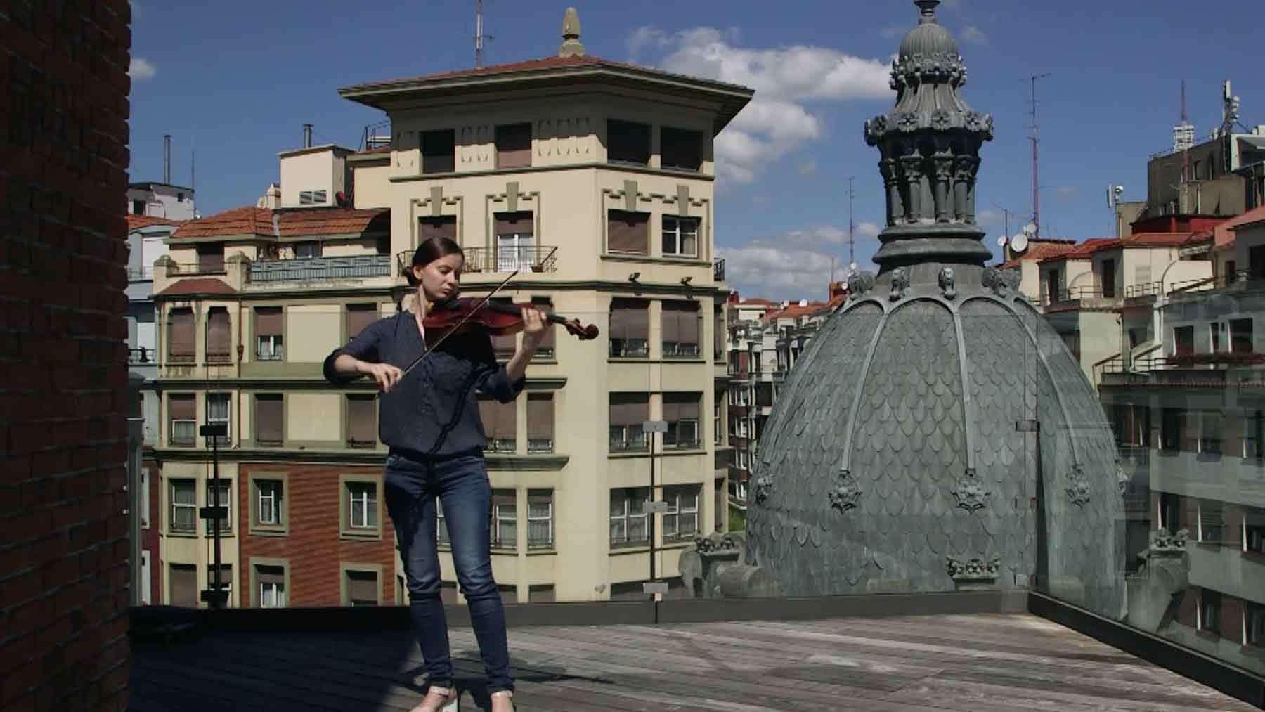 Video screenshot of street musicians performing as part of Carlos Garaicoa's Partitura. © Carlos Garaicoa.