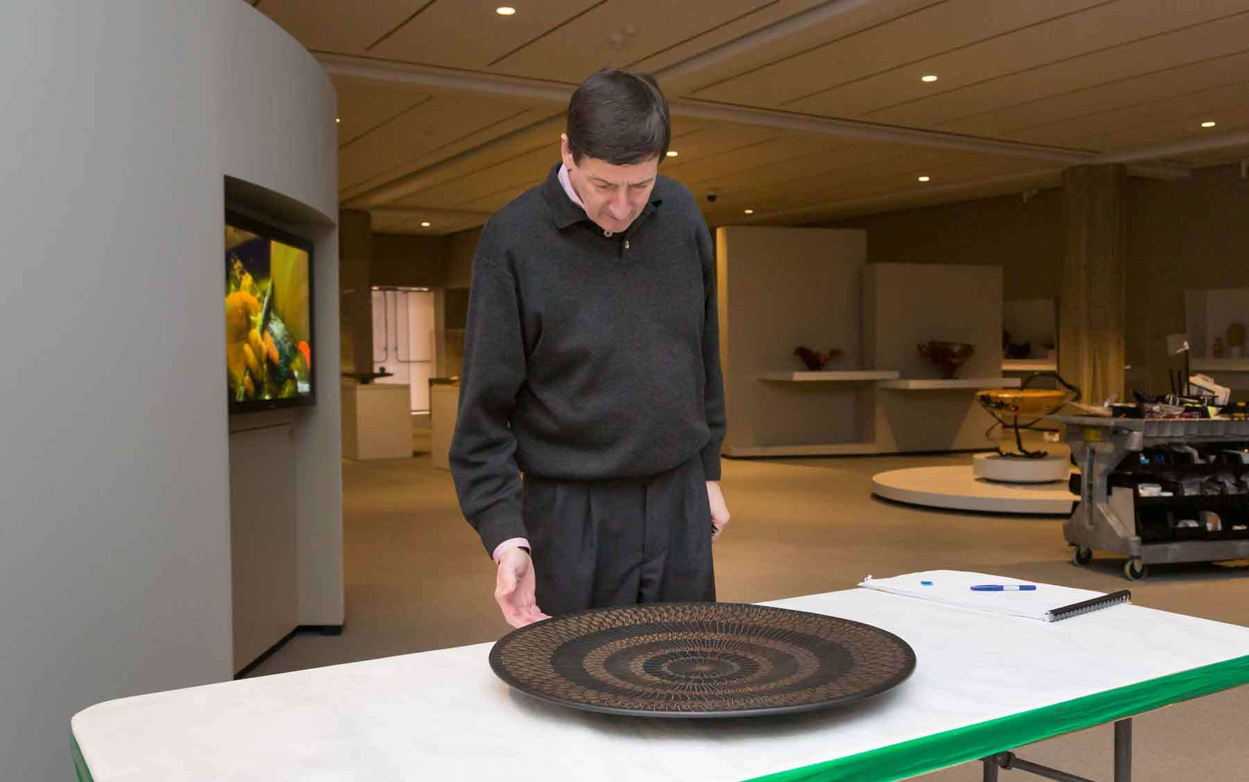 Dean during installation of Audacious: The Fine Art of Wood from the Montalto Bohlen Collection.
