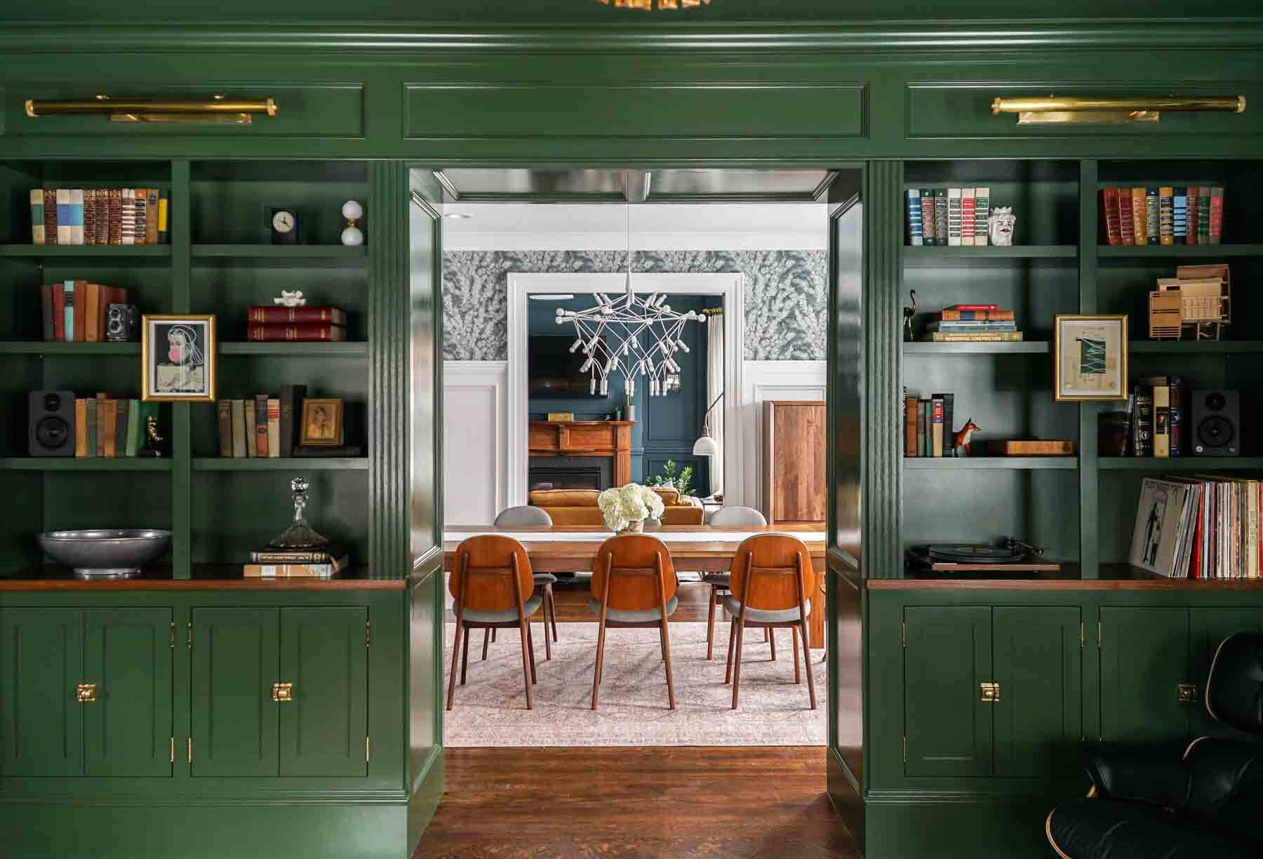 A bold green splashes across the walls of the Victorian parlor