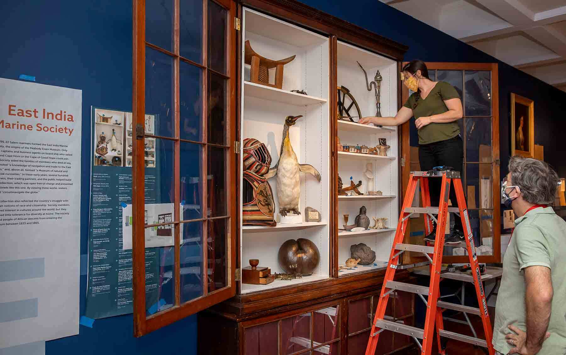 East India Marine Hall case being installed in the Salem Stories exhibition. Photo by Kathy Tarantola/PEM