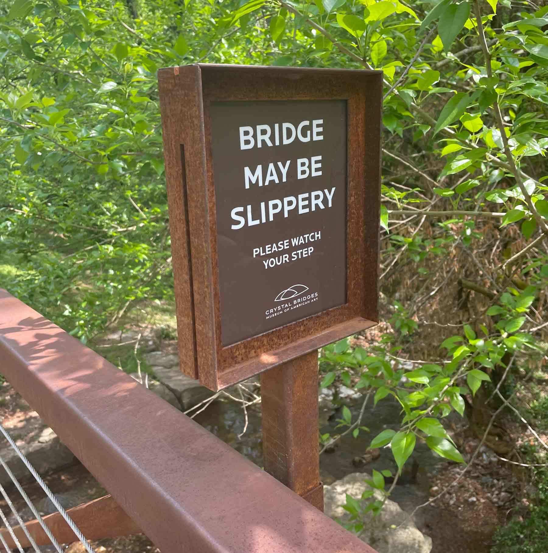Bridge may be slippery sign