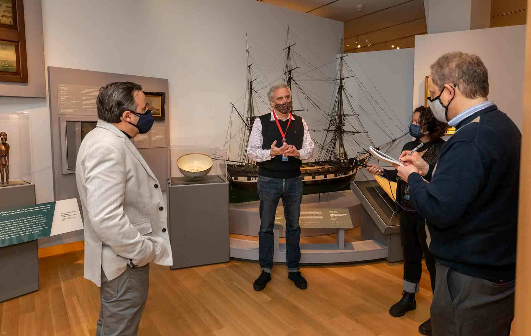 Dan Finamore talking to a gropu of people in the Maritime gallery