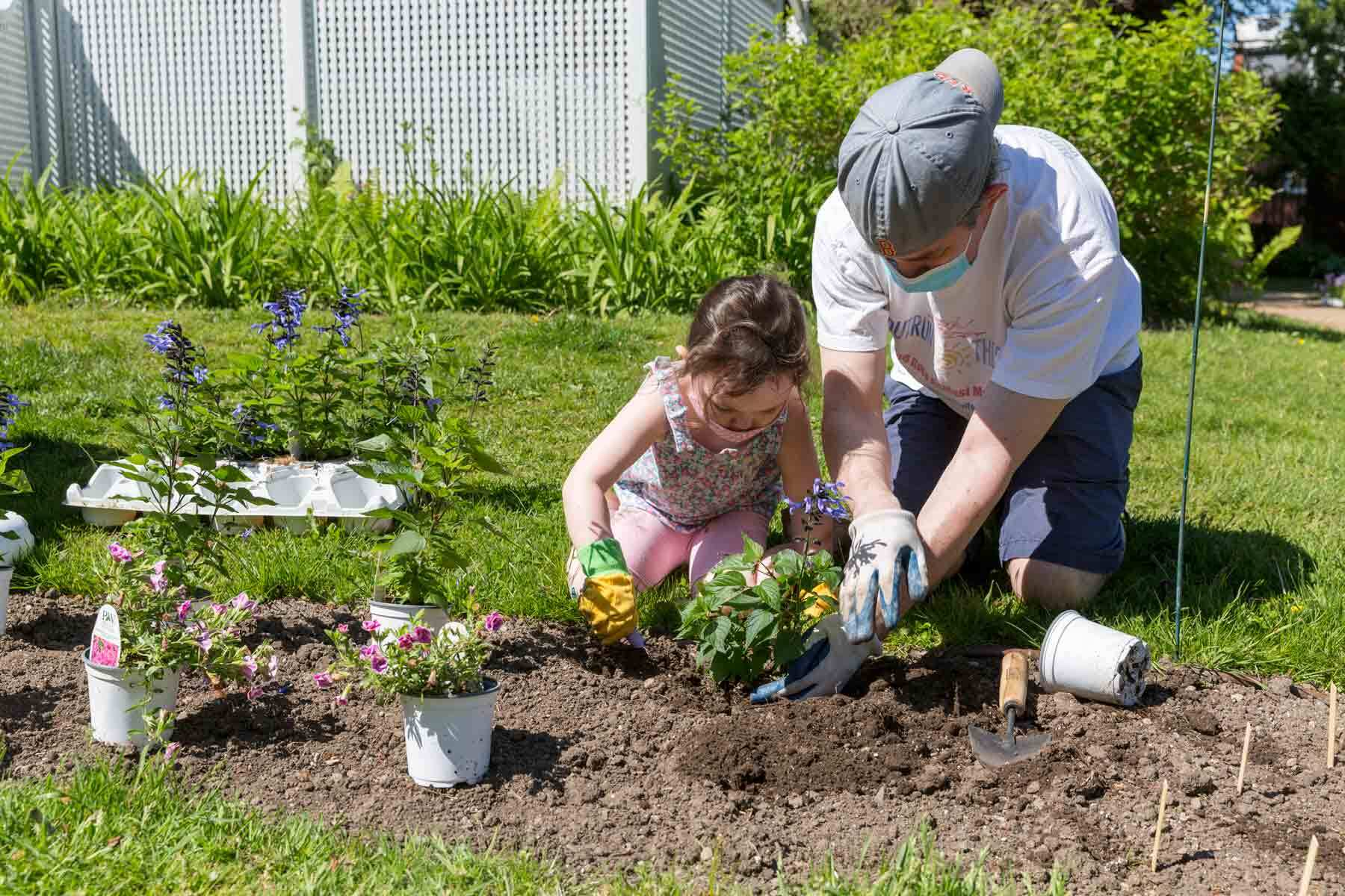 A young family gardening at the Ropes Mansion.