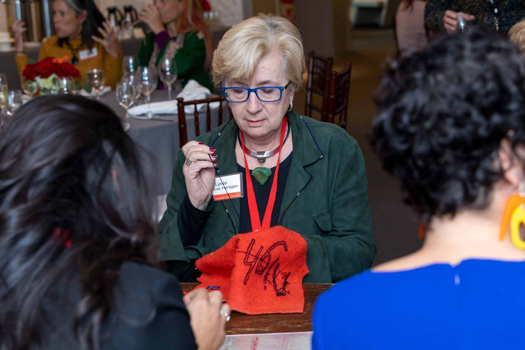 Lynda in a community sewing circle at PEM with Seneca artist Marie Watt. Each/Other: Marie Watt and Cannupa Hanska Luger opens in January. Photo by Kathy Tarantola