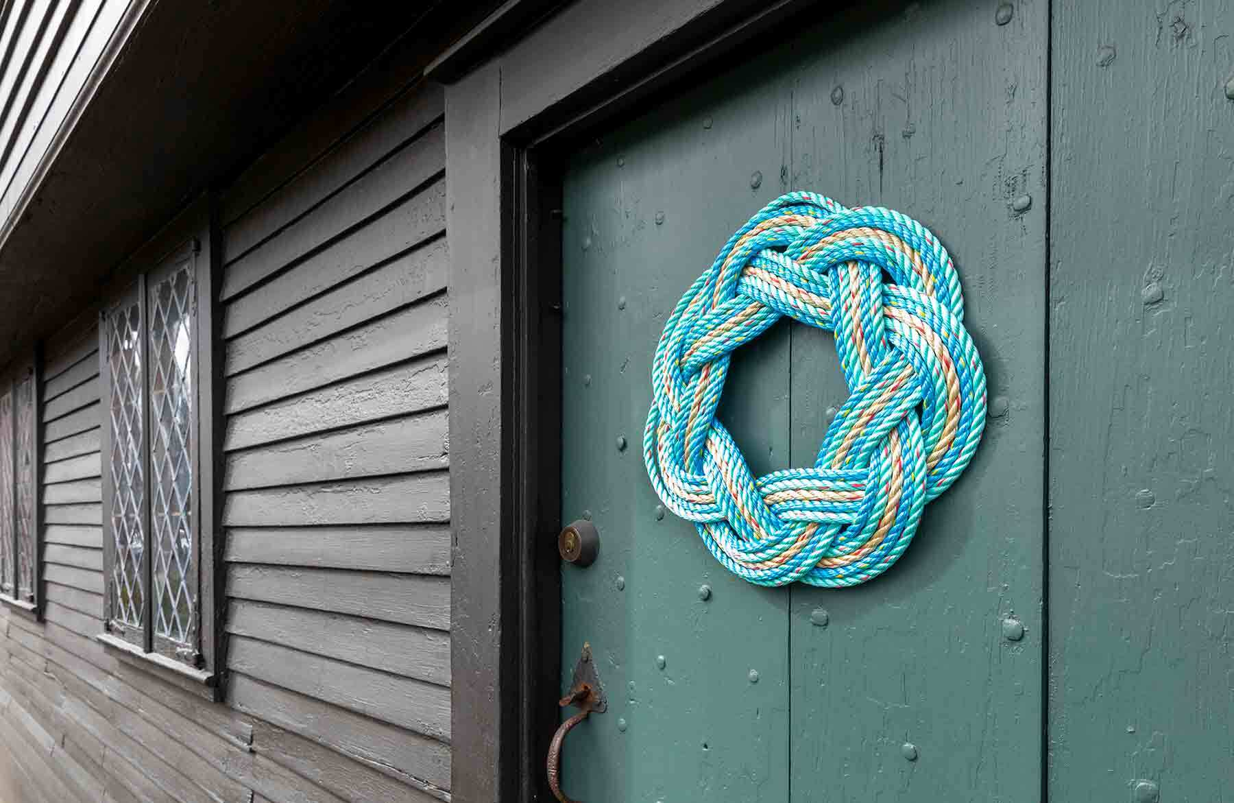A blue rope wreath on the door of the John Ward House