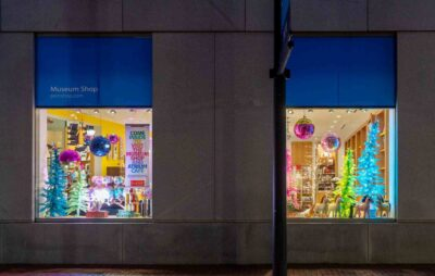 The PEM shop windows light up at night with rainbow colors