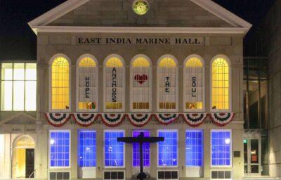 Henry Rutkowski lit East India Marine Hall during quarantine, Spring 2020.  Photo by Paige Besse.