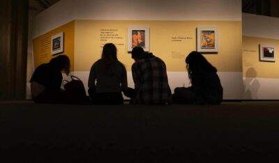 Art students in Jacob Lawrence: The American Struggle. Photo by Bob Packert/PEM.