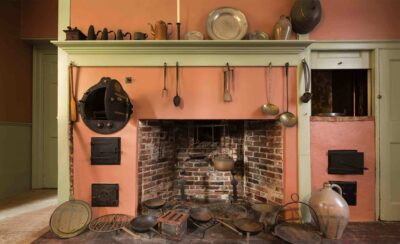 An early fireplace with kitchen tools hanging on peach colored front of fireplace, Interior of the Gardner-Pingree House
