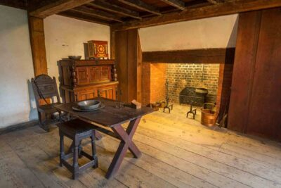 Interior view of table and fireplace inside John Ward House