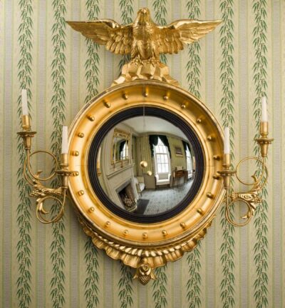 A hanging round mirror inside the Peirce-Nichols house