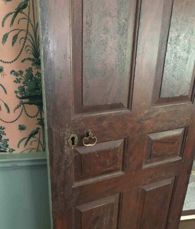 A dark wooden grained parlor door