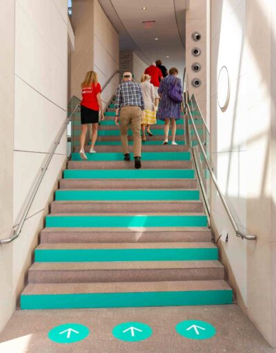 Visitors climb the one-way staircase from the Main Atrium.