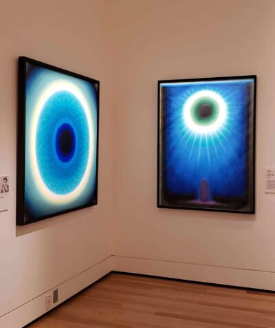 These two paintings by the artist Biren De appear illuminated from within due to the deliberate focus on the areas of the objects that give the sense of light. Photo by Angela Segalla.