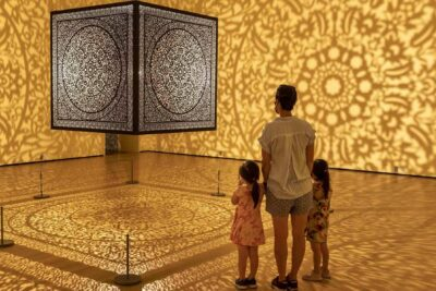 Guests in Anila Agha's All the Flowers Are for Me. © 2020 Peabody Essex Museum. Photograph by Kathy Tarantola