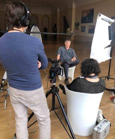 The team interviews Alexis Rockman. Photo by Kristen Levesque