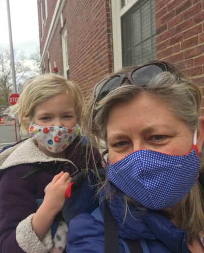 Karina Corrigan and her daughter, Anneke, out for a walk during lockdown, wearing masks made by PEM colleague Sarah Chasse.