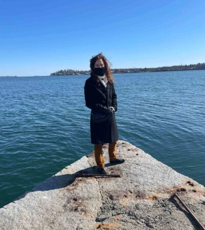 Jane Winchell, PEM's Director of the Dotty Brown Art and Nature Center on Derby Wharf with the ocean in the background