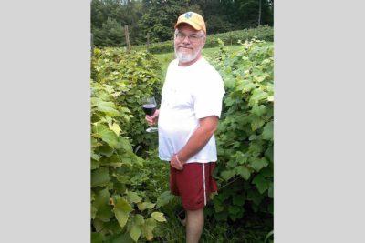 Steven standing in a vineyard
