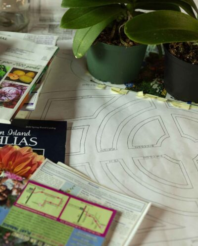 Circular paths garden plan and books laid on a surface