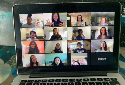 Students faces forming a grid on a desktop screen