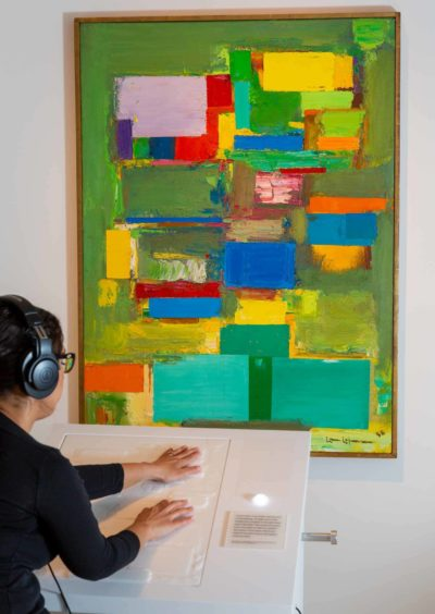 visitors explore the new tactile reproduction in Hans Hofmann