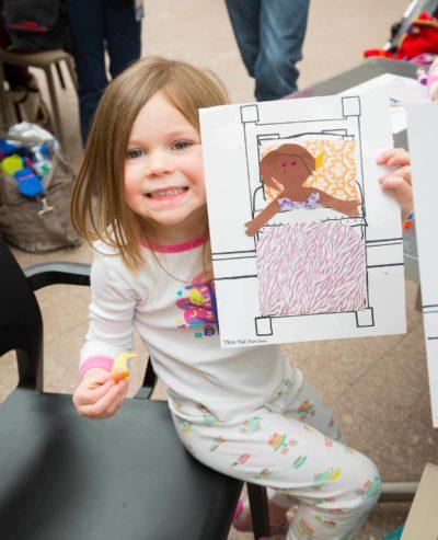 girl creating in drop in art activity