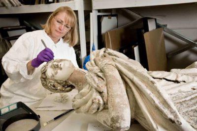 figurehead with conservator Mimi Leveque