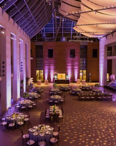 Night time view of the Atrium with tables set for a wedding reception