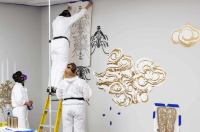 Artist Vanessa Platacis installing her work, Taking Place.