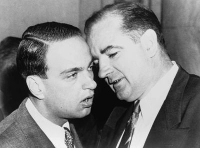 Joseph McCarthy and his chief consul, Roy Cohn whispering during the Army-McCarthy hearings, June 11, 1954. Courtesy of Everett Collection Historical/Alamy Stock Photo
