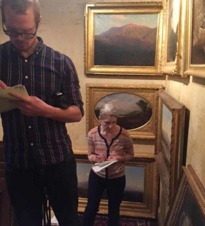 PEM staff Adam Brooksand Sarah Chasse documenting the paintings in the couple's home.