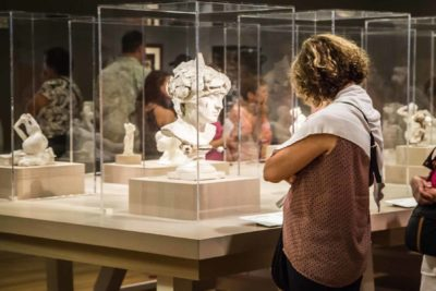 Visitors experiencing the sculptures of Auguste Rodin.