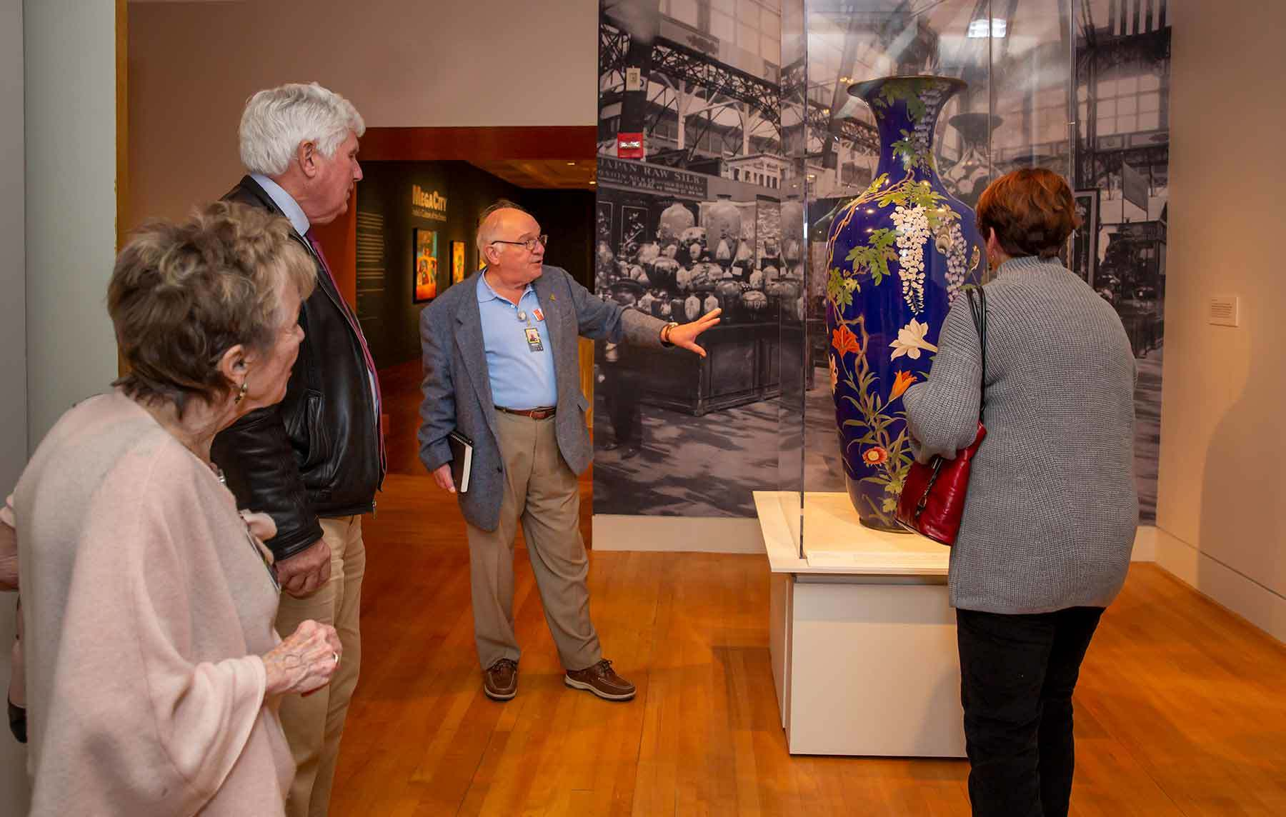 Meibaum leads a group of visitors in the museum