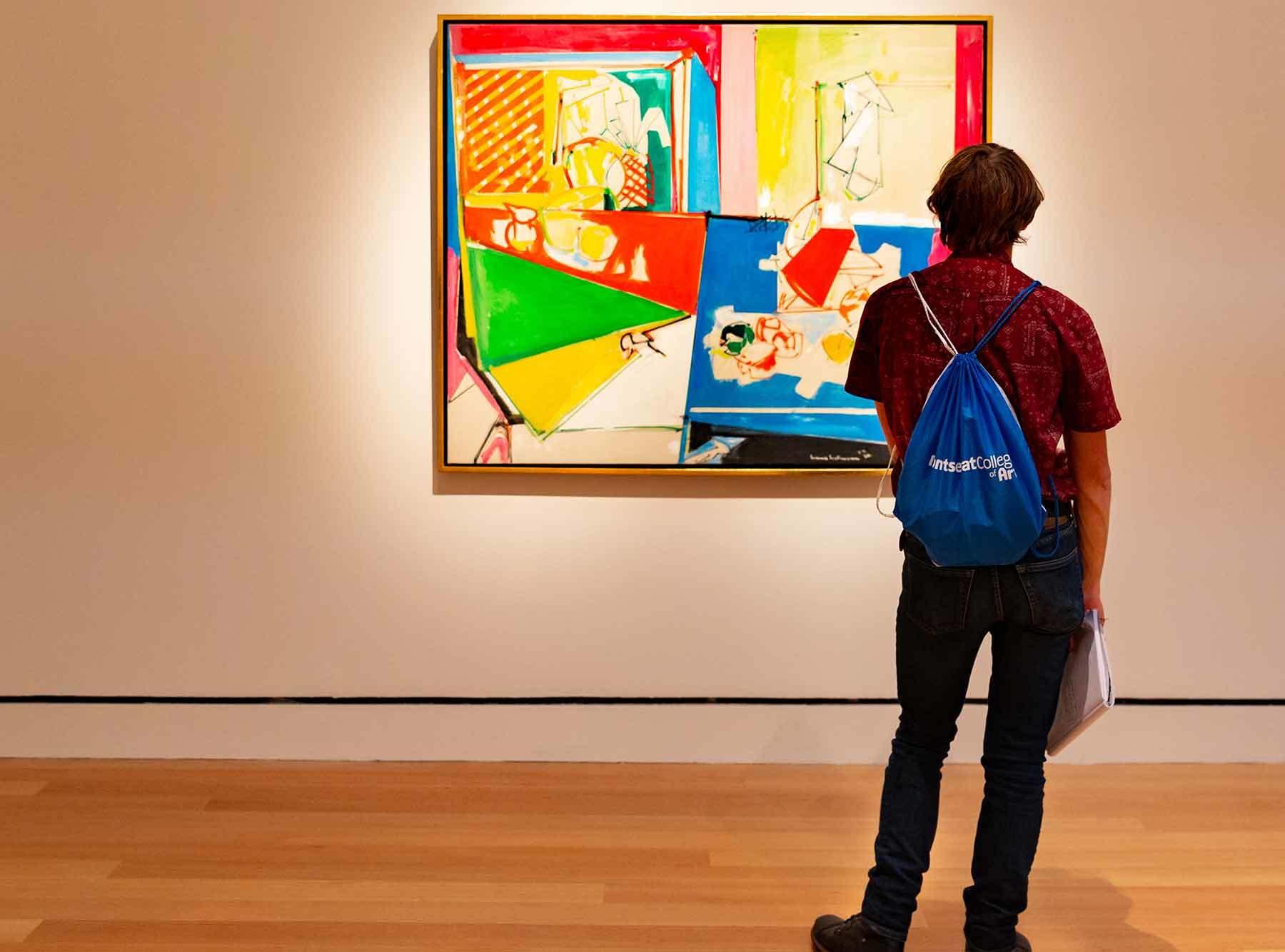 An art student gazes at Hofmann's 1950 work Magenta and Blue