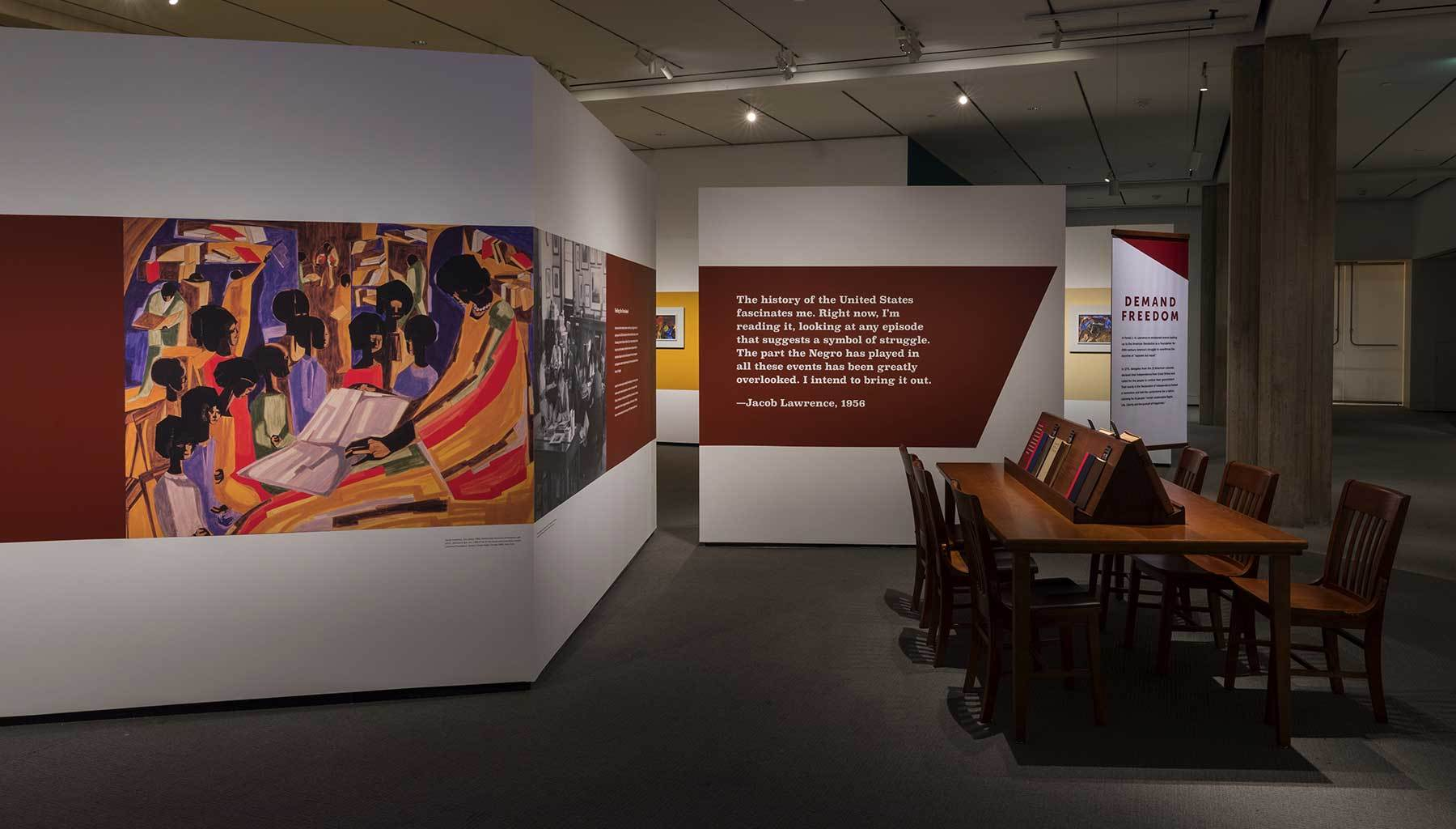 Jacob Lawrence, The Library, 1960 on the wall of the installation of  Jacob Lawrence: The American Struggle.