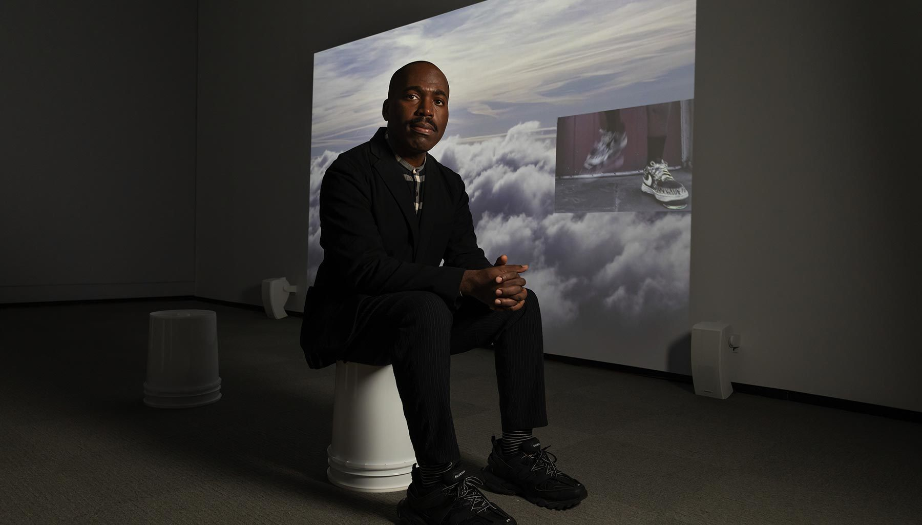 Artist Derrick Adams in his installation of Saints March in  Jacob Lawrence: The American Struggle. Photo by Kathy Tarantola/PEM.