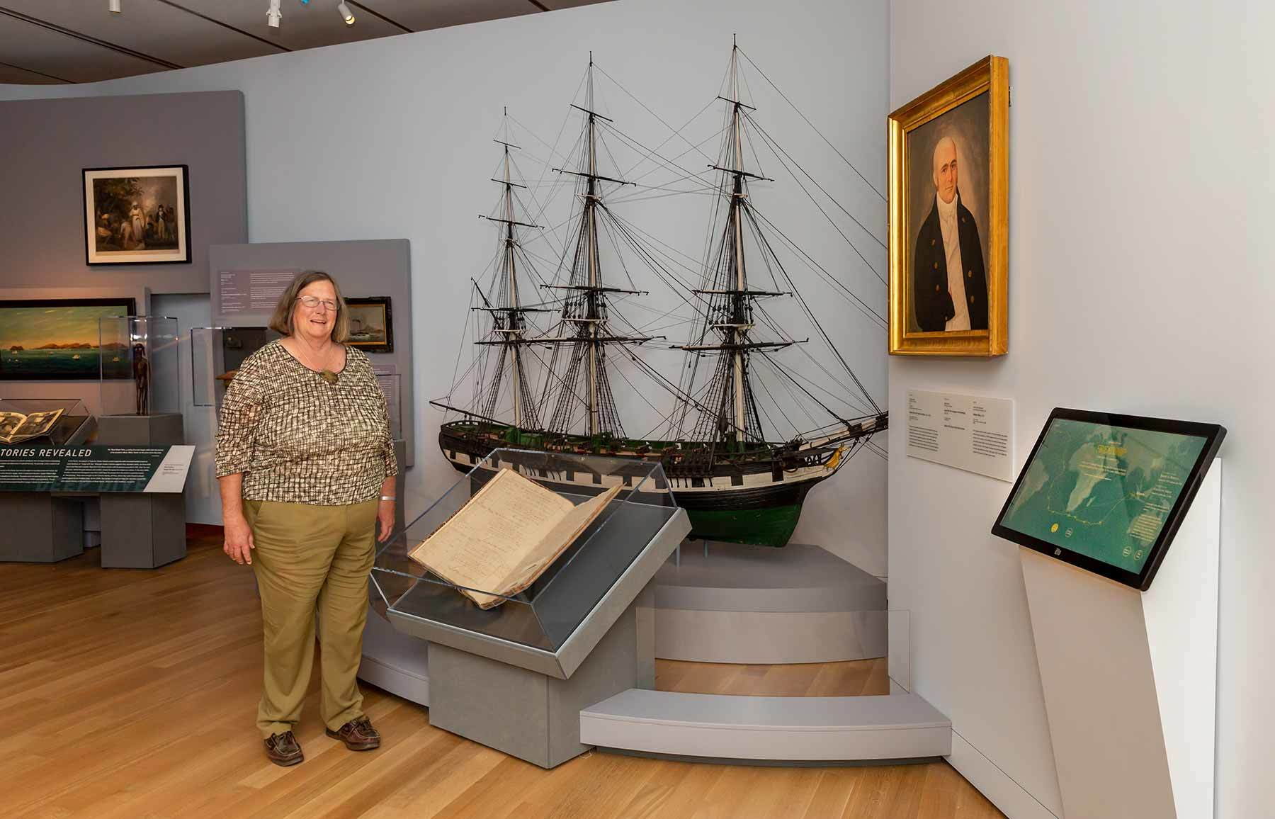 Joanie Ingraham in maritime art gallery