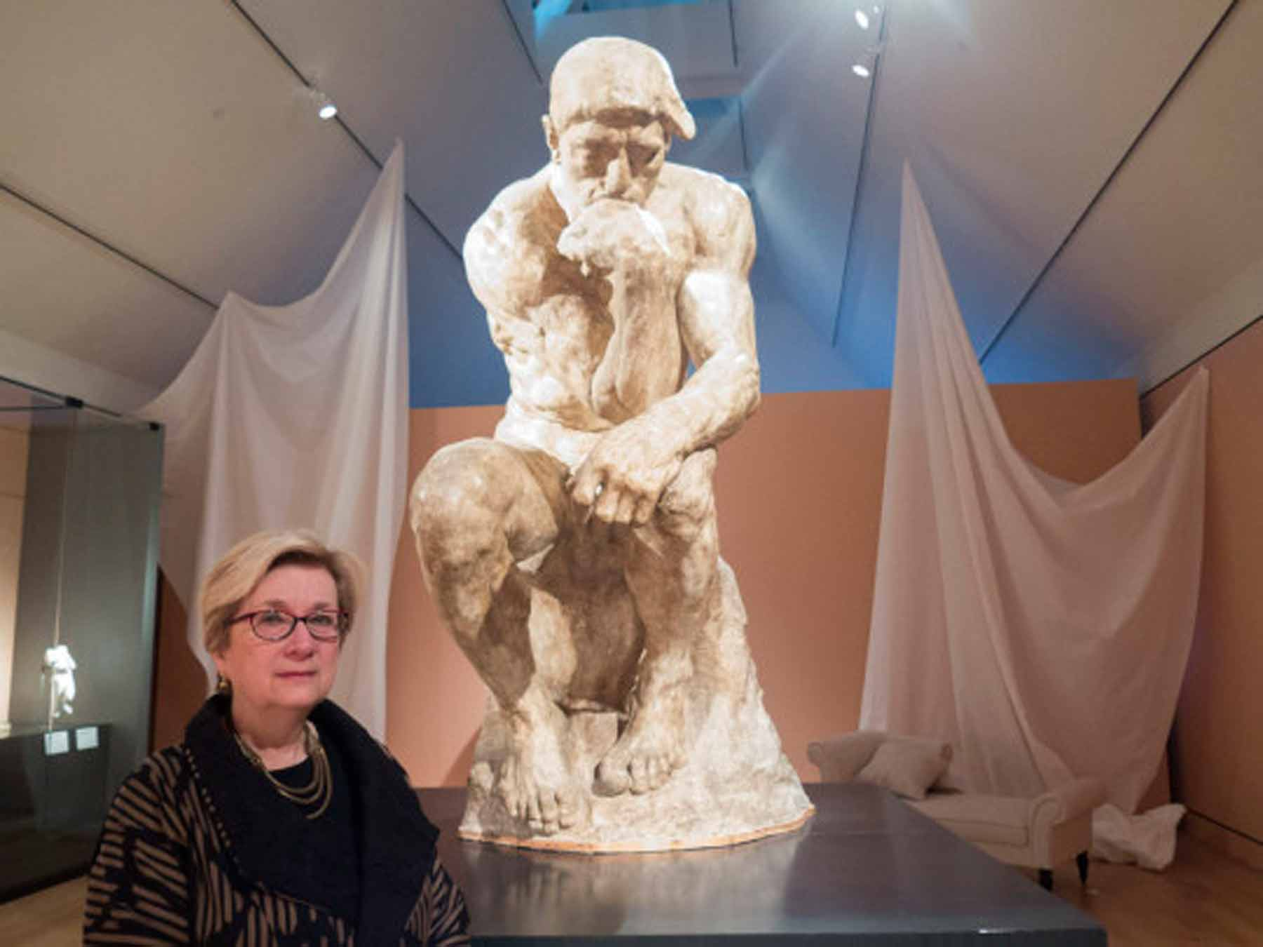 "Lynda Roscoe Hartigan, deputy director of the Peabody Essex Museum and co-curator of the exhibit ""Rodin: Transforming Sculpture,"" stands in front of Rodin's ""The Thinker."" Photo by Andrea Shea/WBUR"