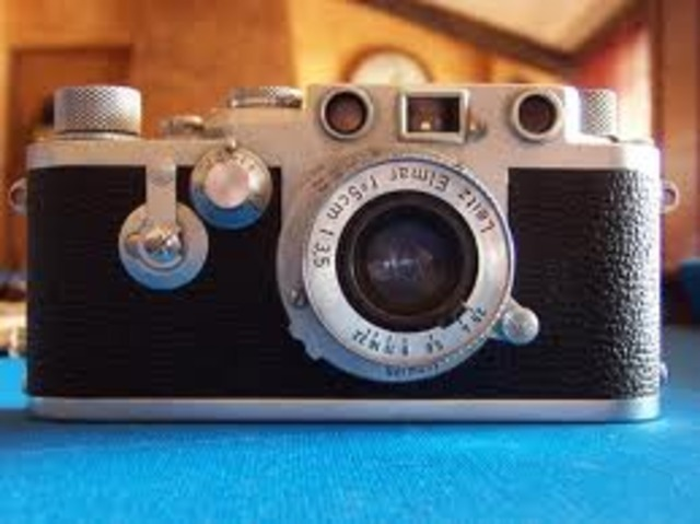 Mis padres se compran una cámara de fotos.