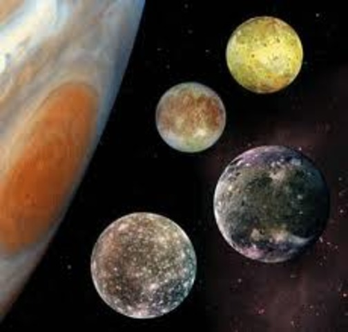Galileo discovers the four moons of Jupiter