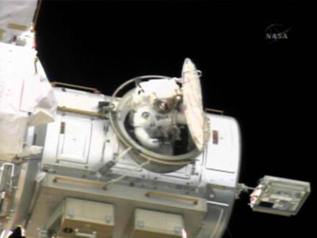 Astronauts outside airlock