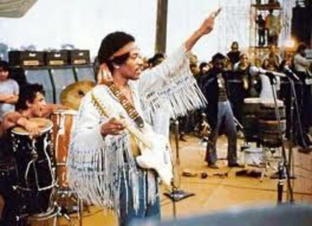 Jimi Hendrix plays at Woodstock