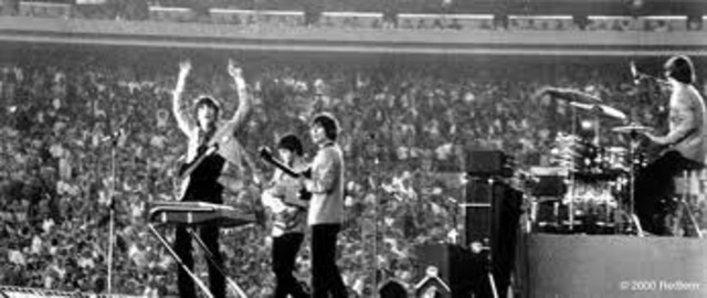 The Beatles play at Shea Stadium