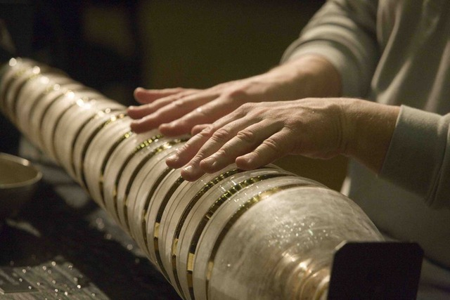 Benjamin Franklin improves the glass harmonica