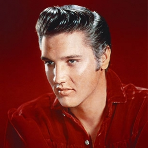 Elvis Presley signs with Sun Records